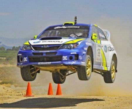 Автомобили в прыжке